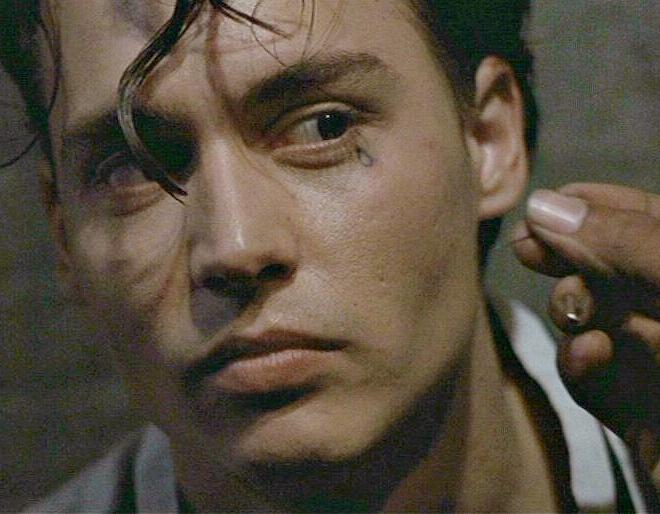 Jhonny Depp in the movie Cry Baby with a teardrop